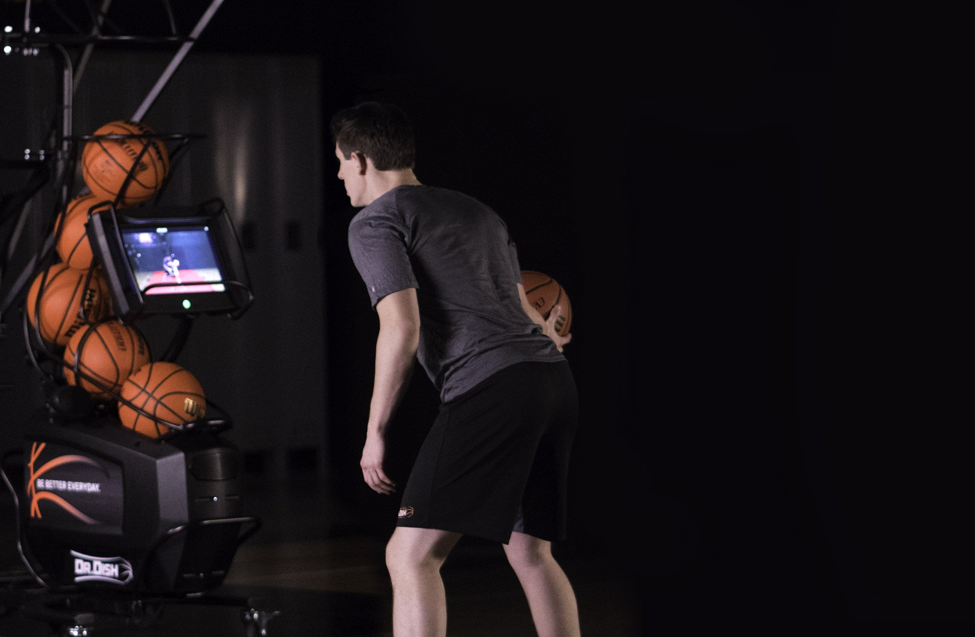 Basketball Player Using Shooting Machine